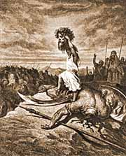 David displays Goliath's head as proof of his victory (Dore)