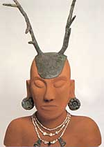 A reproduction of 'Hopewell Man', adorned with a native-copper headpiece, earspools, and three strands of freshwater pearls embellished with copper and silver pendants.